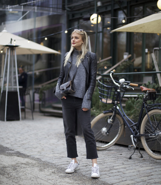 Jennifer Sandsjö is wearing this suave and sophisticated new trend through a marl grey sweater paired with cropped black jeans and a swanky leather jacket. Brands Not Specified.