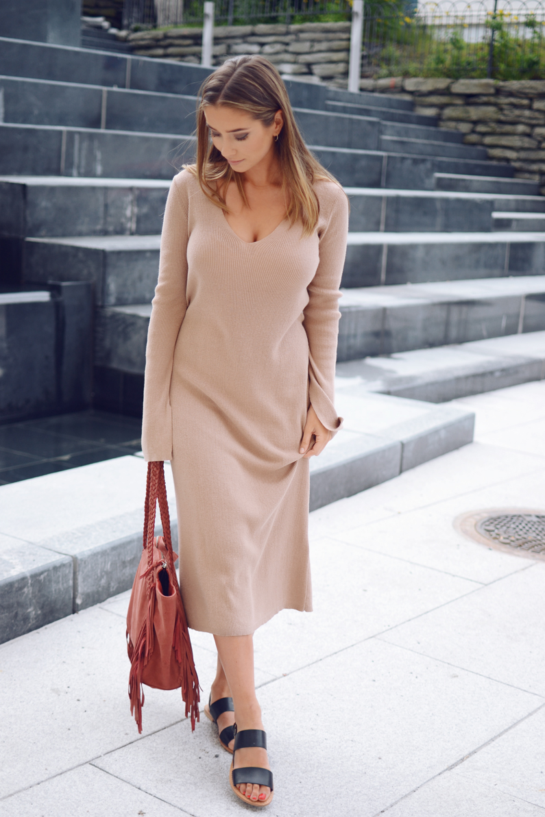 A dress with extra long sleeves can really accentuate features and add another dimension to your outfit. Try a camel number like Emilie Tommerberg. Sandals: DNA.