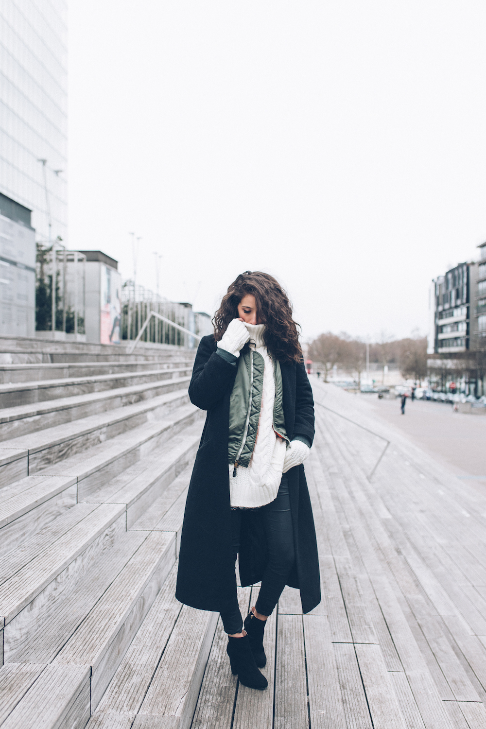 Wear extra long sleeves as part of a knitwear look like Alexandra Guerain to get a warm and cosy winter feel. Throw on a black maxi coat and ankle boots to steal this style! Coat: Asos, Bombers: Vintage, Sweater: Anine Bing, Jeans: Zara, Shoes: Minelle x Gerogia May Jagger.