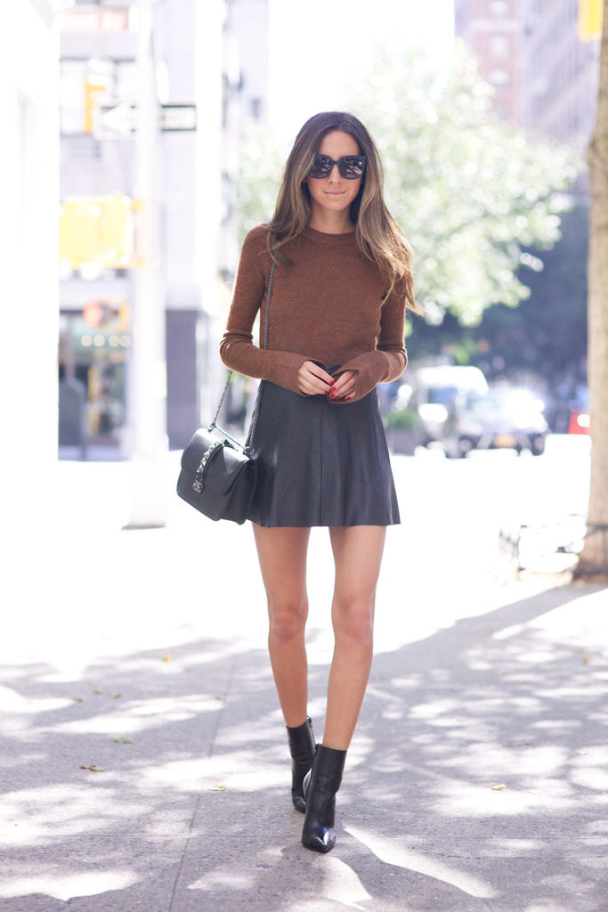 Arielle Nachami wears an extra long sleeve chocolate knit with a cute pleated skirt and ankle boots.   Skirt: Love Leather, Top: Zara, Boots: Christian Louboutin, Bag: Valentino.