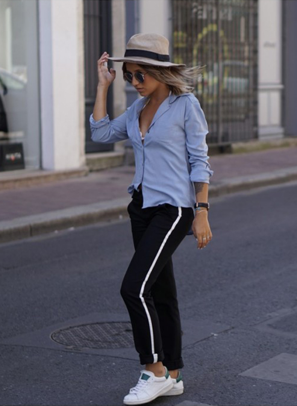 You can never go wrong in a pair of classic black stripe joggers. Camille Callen wears this pair with a pale blue blouse and sneakers.   Shirt: Sheinside, Joggers: Zara, Sneakers: Dada Noholita.