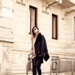 Jana Wind wears a shearling jacket over leather leggings and a cute cream top. Jacket/Trousers/Shoes: Guess.