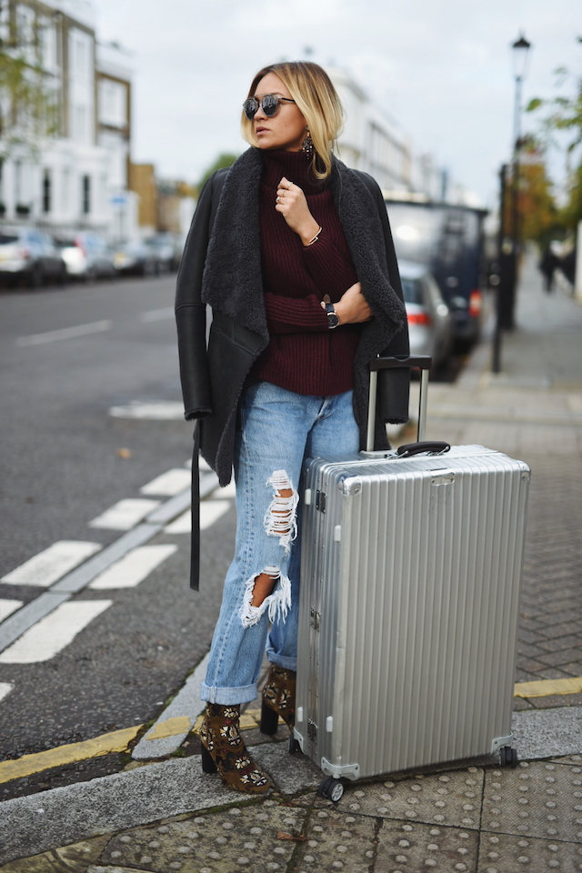 The shearling coat trend looks great worn with distressed denim, as demonstrated here by Nina-Victoria Suess.   Coat/Sweater: Drykorn, Jeans: Levi's, Shoes: Isabel Marant.