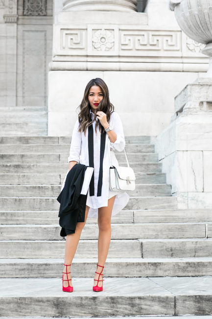 Wendy Nguyen knows exactly how to style the skinny scarf trend. Paired simply with an oversized boyfriend style blouse, this contrast of black and white creates an androgynous look which we just love.   Shirtdress: Marissa Webb, Shoes: Christian Louboutin.