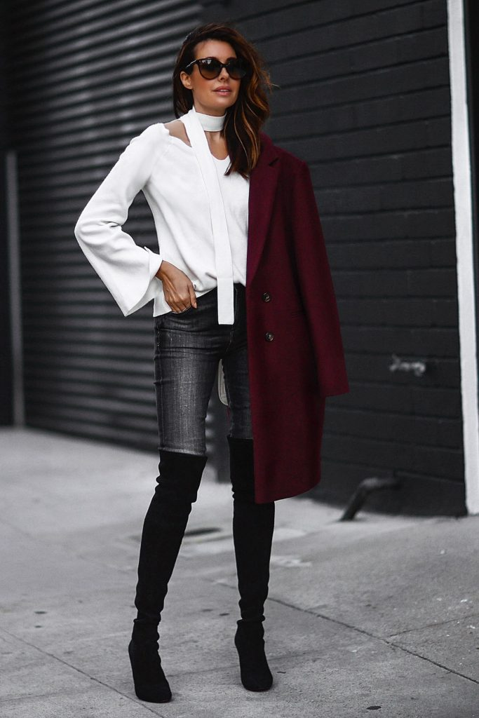 Skinny scarves are a fabulous way to add that edge to your everyday style. Take inspiration from Erica Hoida, who is pairing this white skinny scarf with a scoop neck blouse and over the knee boots for a sexy, smart casual style! Jacket: Sezane, Sweater: Chicwish, Jeans: Citizens of Humanity, Boots: Stuart Weitzman, Bag: Gucci.