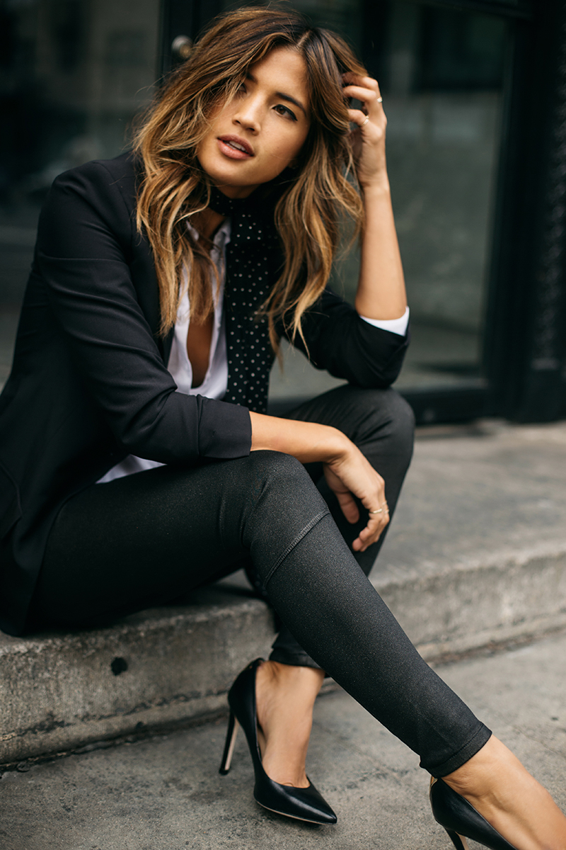 When wearing the skinny scarf trend, you can easily spruce up your run of the mill blazer and jeans look. Try a polka dot version which adds elegance to your outfit. Via Rocky Barnes.