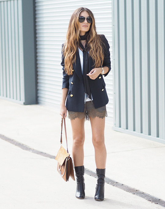 Lydia Lise Millen wears a skinny black scarf with lace khaki shorts and a navy blazer. Shorts: H&M, Blazer: LaRedoute, Boots: Chloe, Watch: Larsson & Jennings, Necktie: ASOS.