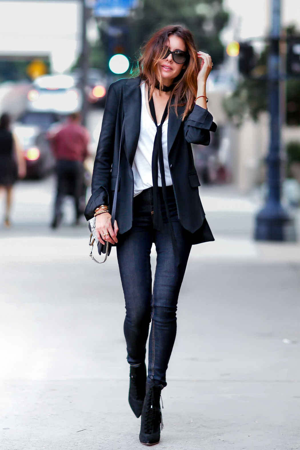 Erica Hoida goes total tomboy with this black blazer, white shirt, and skinny black tie combination. Blazer: Marissa Webb, Shirt: The Row, Jeans: Rag & Bone, Scarf: Chloe.