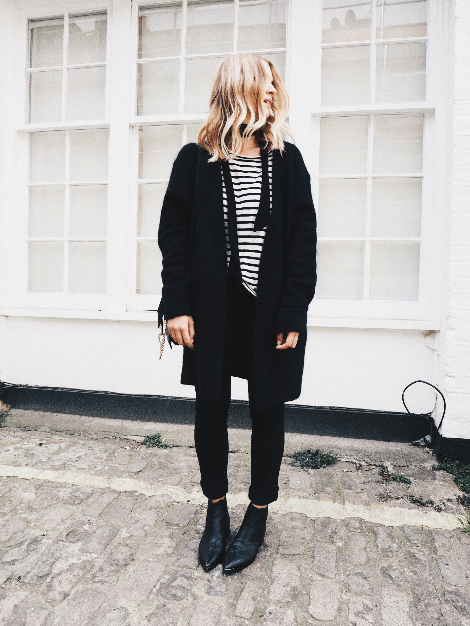 Mirjam Flatau rocks monochrome in this striped top and skinny black scarf. Bag/Scarf: Chloe, Cardigan: ACNE Studios.