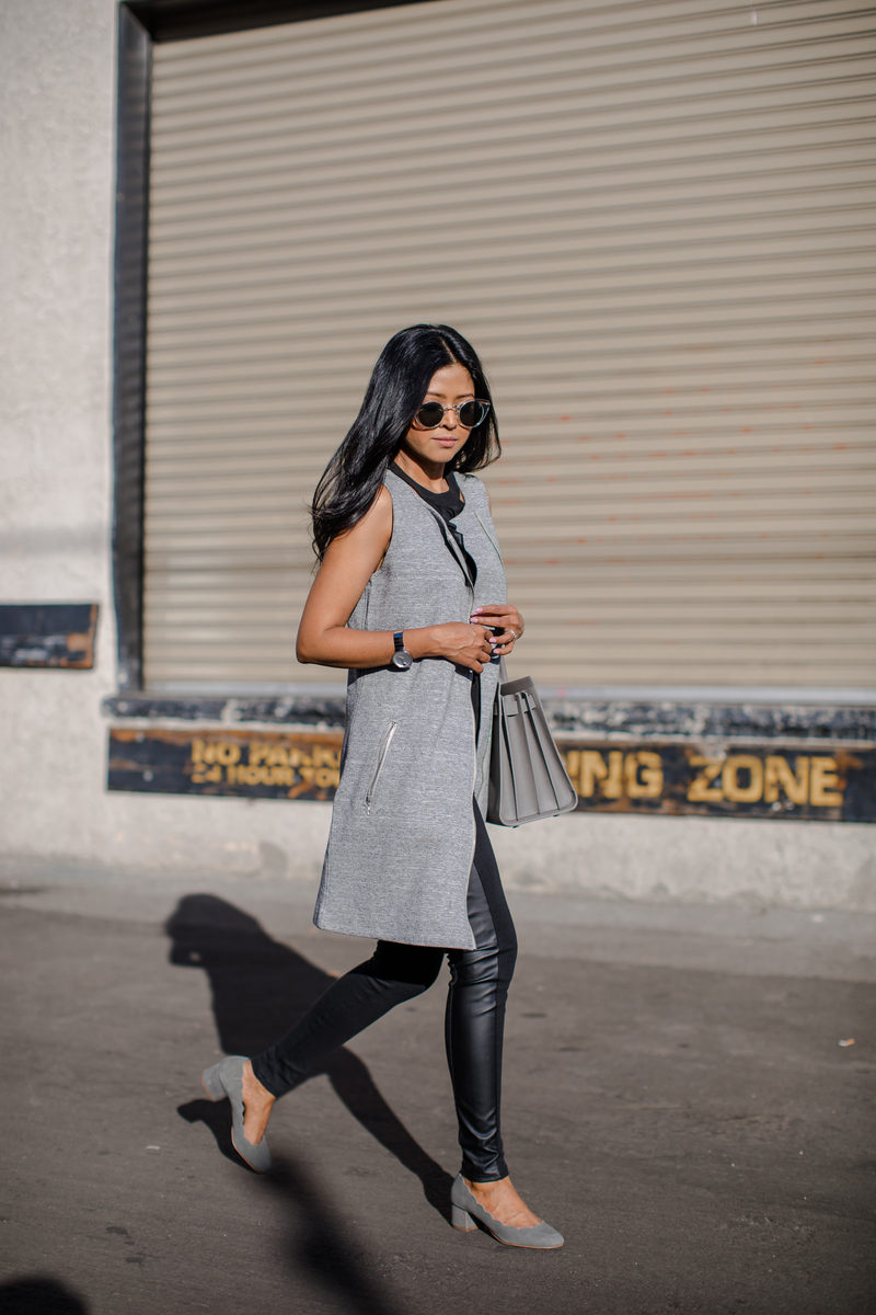Sheryl Luke is utterly chic in this marl grey sleeveless jacket, worn with leather leggings for a smart casual style to die for! Try this look with suede shoes to get Sheryl's exact winter style. Jacket: Macy's.