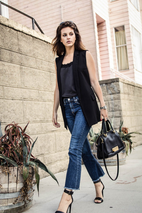 A sleeveless jacket is a sure fire way to attain a smart and sophisticated style. Jackie is looking stylish and elegant in this black jacket, paired with gorgeous straight leg jeans and stilettos. Top: Stitch Fix, Heels: Tibi, Bag: Zac Posen, Vest: Club Monaco, Jeans: Rag & Bone.