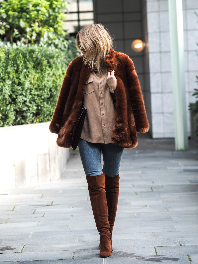 Lene Orvik is a vision in terracotta rust, wearing a stylish coloured fur coat and over the knee boots. Coat/Boots: Zara, Jeans: Levi's.