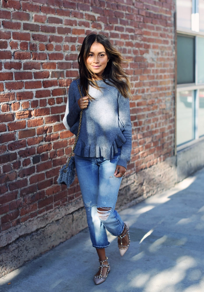 Try wearing a cute ruffle sweater with pale denim jeans and studded flats to recreate Julie Sarinana's warm autumnal style. For cooler temperatures, add a simple jacket or scarf to amend the look without reducing the style. Sweater: Storets, Jeans: Levi's, Shoes: Valentino, Bag: Proenza Schouler.