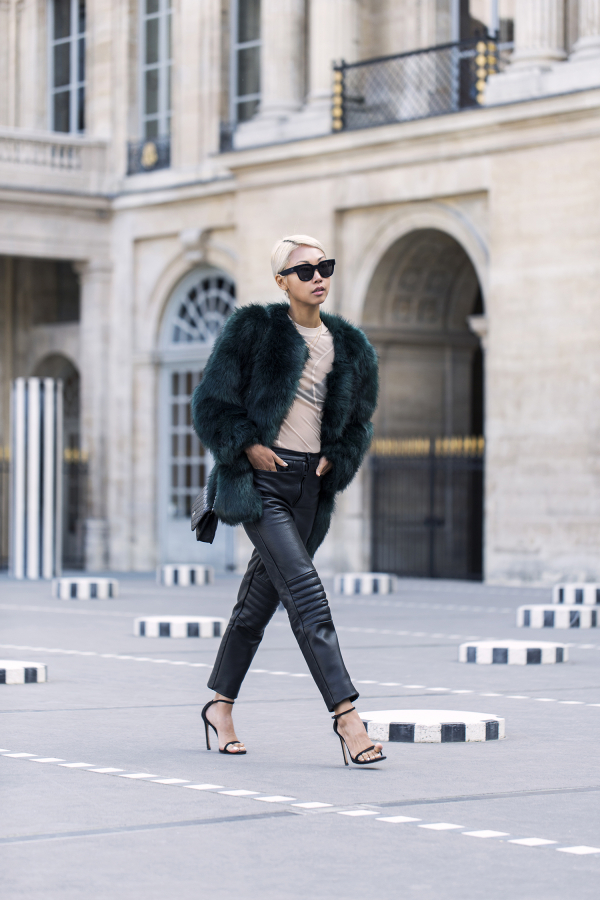 A fluffy fur coat is ideal for the colder days this season! Vanessa Hong rocks this gorgeous emerald number from Thpshop, pairing it with a trendy pair of leather trousers and stylish strappy heels. Coat: Thpshop.co, Top: Acne, Trousers: Charlie May, Shoes: Stuart Weitzman, Clutch: Chanel.