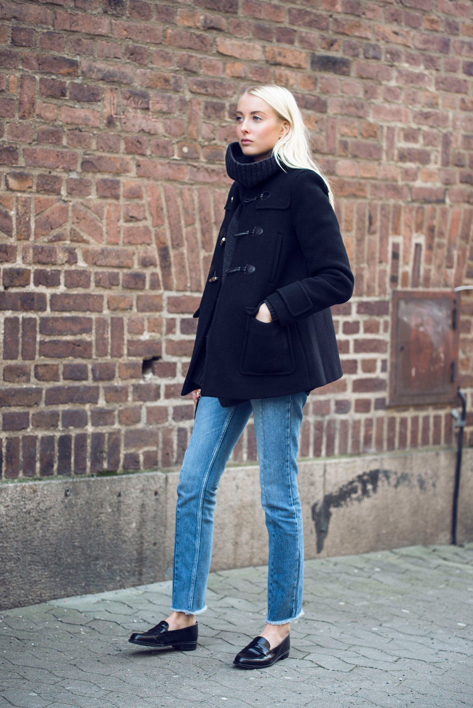 Rock the classic retro style by combining an everyday outfit with a pair of penny loafers. Ellen Claesson wears jeans and a cute duffle coat with these stylish navy loafers; making for an overall stylish and casual look. Jacket/Jeans: Sandro Paris, Turtleneck: Ralph Lauren, Loafers: Nilsson.