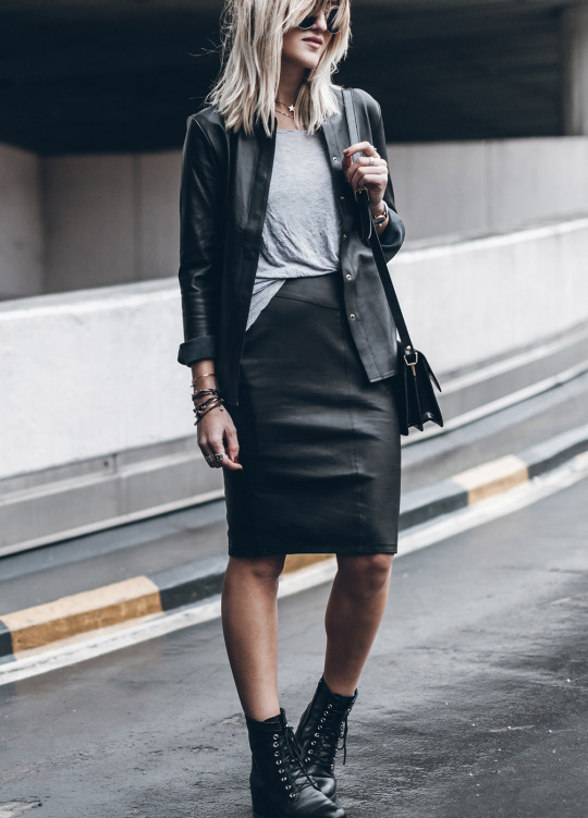 Dare to wear double leather this season! Jacqueline Mikuta looks ultra cool in a matching leather skirt and shirt combination, finished off with classic laced combat boots and a cross body bag. Shirt/Skirt: Sally Blue, Boots: Esprit, Bag: Ganni.