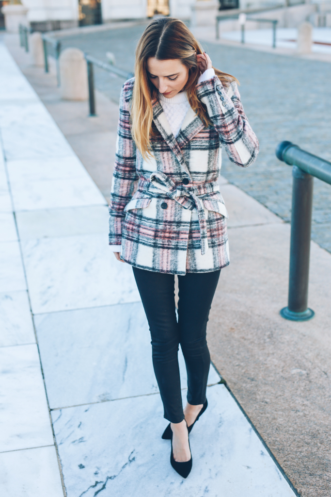 Jess Ann Kirby wears a gorgeous plaid print waist-tie coat with black skinny jeans and matching minimalistic black heels. The warm colours of this coat are perfect for the coming winter season. Coat/Skinny Jeans: Paige Denim, Sweater: AYR, Shoes: Ann Taylor.
