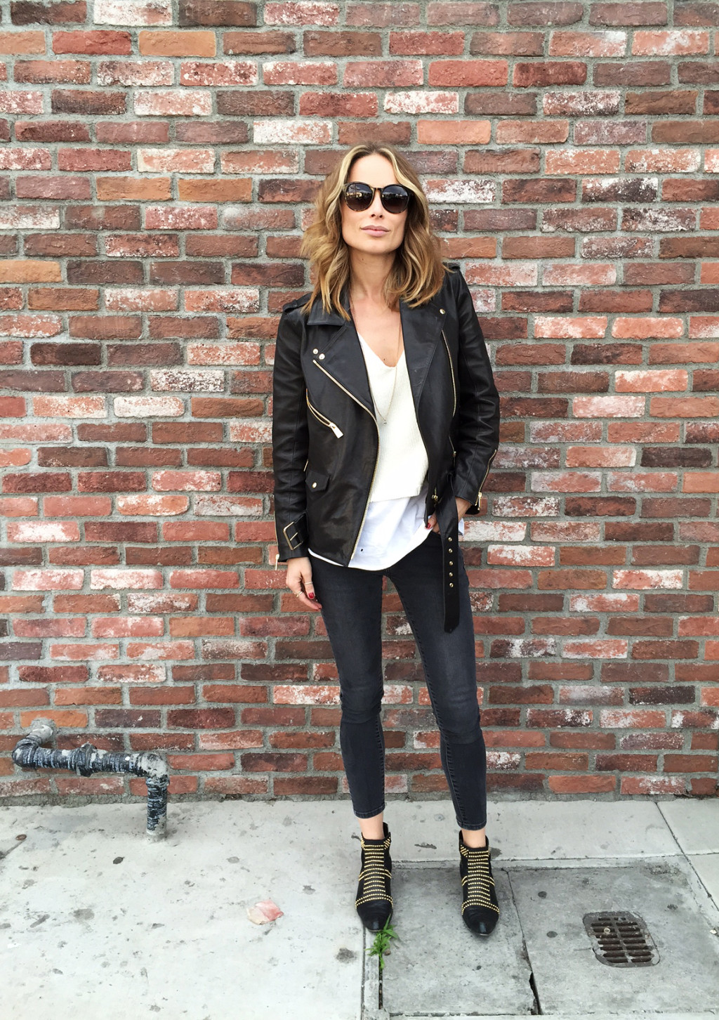 If you're aiming for a cool and casual style, try pairing a leather jacket with skinny denim jeans and a plain white tee. This look is super easy, but will always afford you a stylish, smart aesthetic. Via Anine Bing. Outfit: Anine Bing.