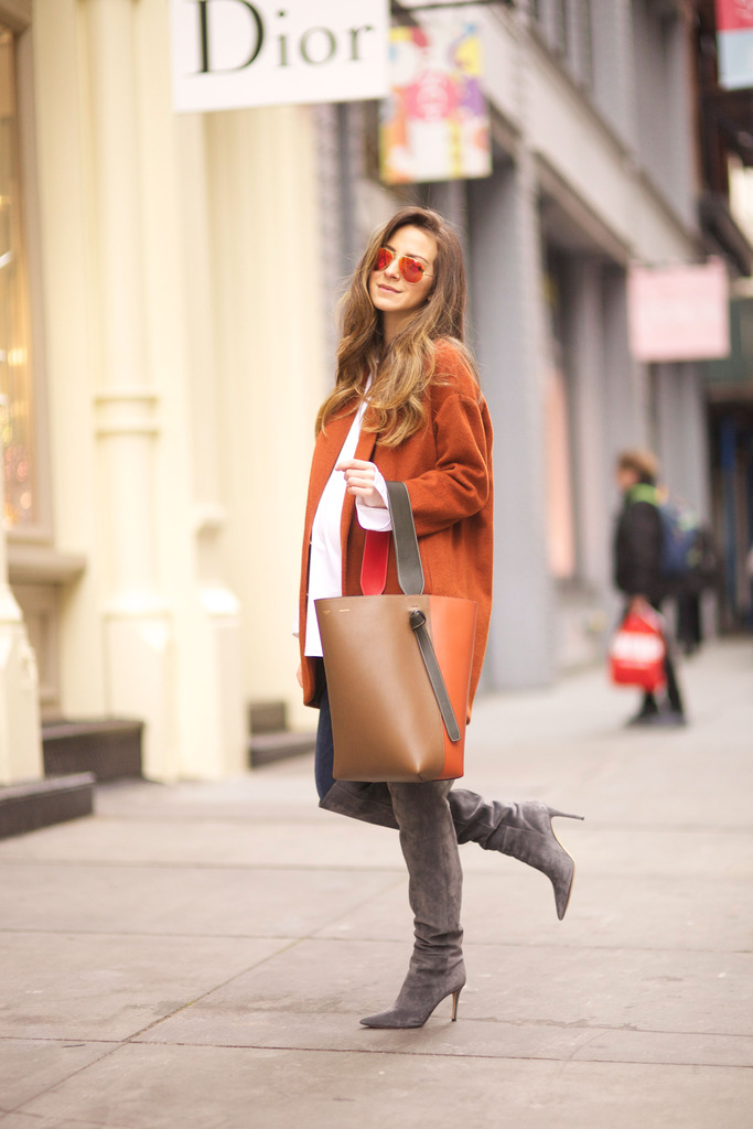 This beautiful shade of burnt out orange is the perfect autumnal colour! Arielle Nachami wears the trend on a stylish long coat, paired with jeans and thigh high boots. Jacket: H&M, Jeans: Citizens of Humanity, Boots: Gianvito Rossi, Shirt: ACNE, Bag: Celine.