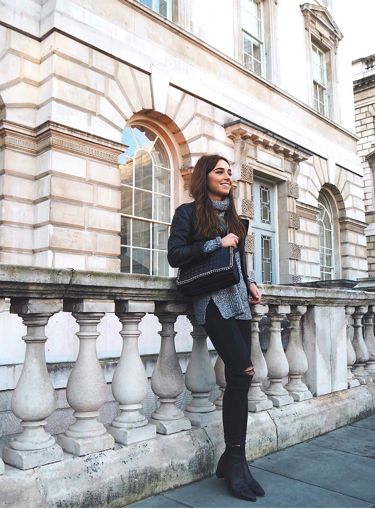 Black leather is the perfect match to dark knitwear. This marl grey polo neck sweater looks cute and cosy worn with Weronika Załazińska's jacket layered over the top. Jumper: H&M, Jeans: Topshop, Boots: Zara.