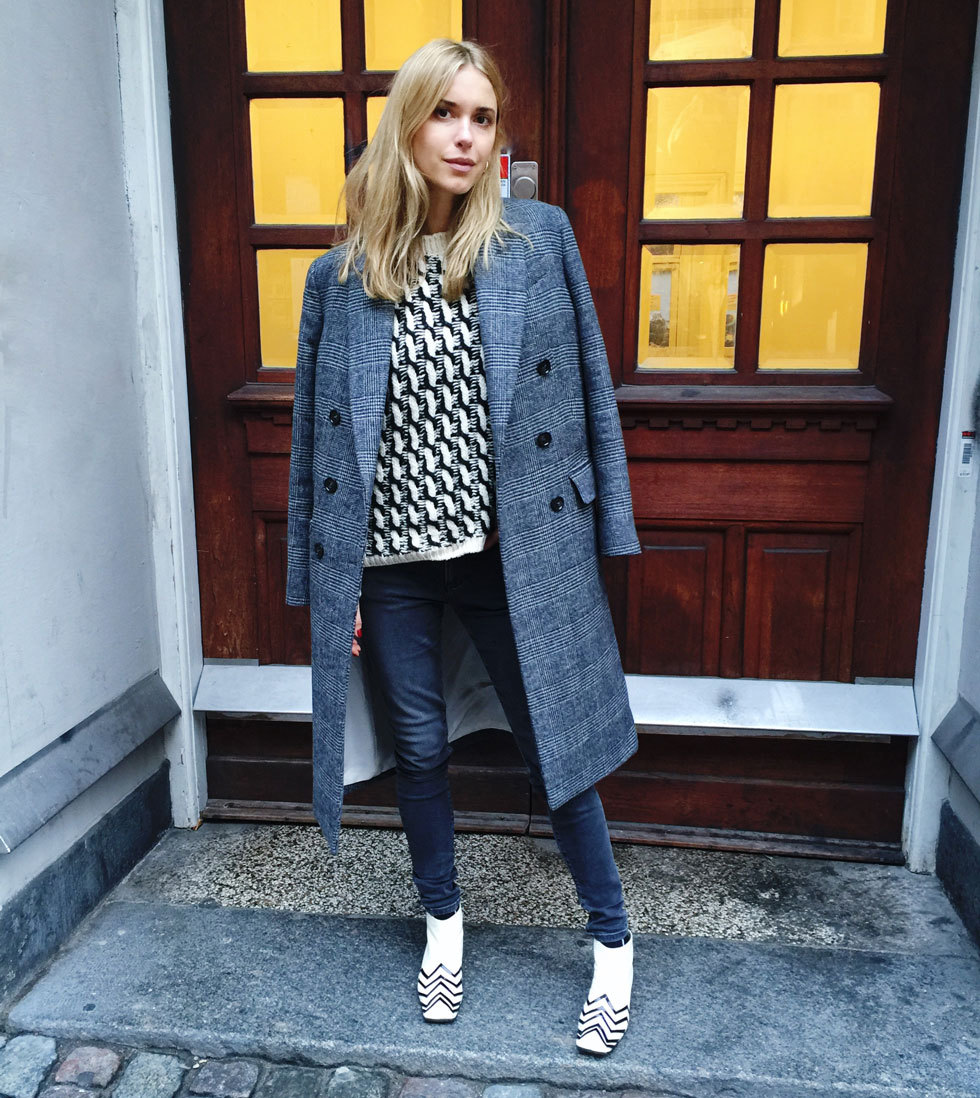 An oversized double breasted suit jacket will instantly smarten up simple jeans and create a great work look. Via Pernille Teisbaek. Coat: By Malene Birger, Knit: Lala Berlin, Jeans: H&M, Boots: Chanel.