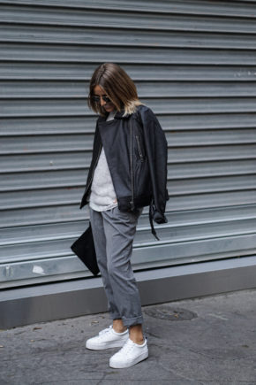 Camille Callen adds an androgynous edge to her look by wearing loose, boyfriend-style slacks and an oversized leather jacket. Brands Not Specified.