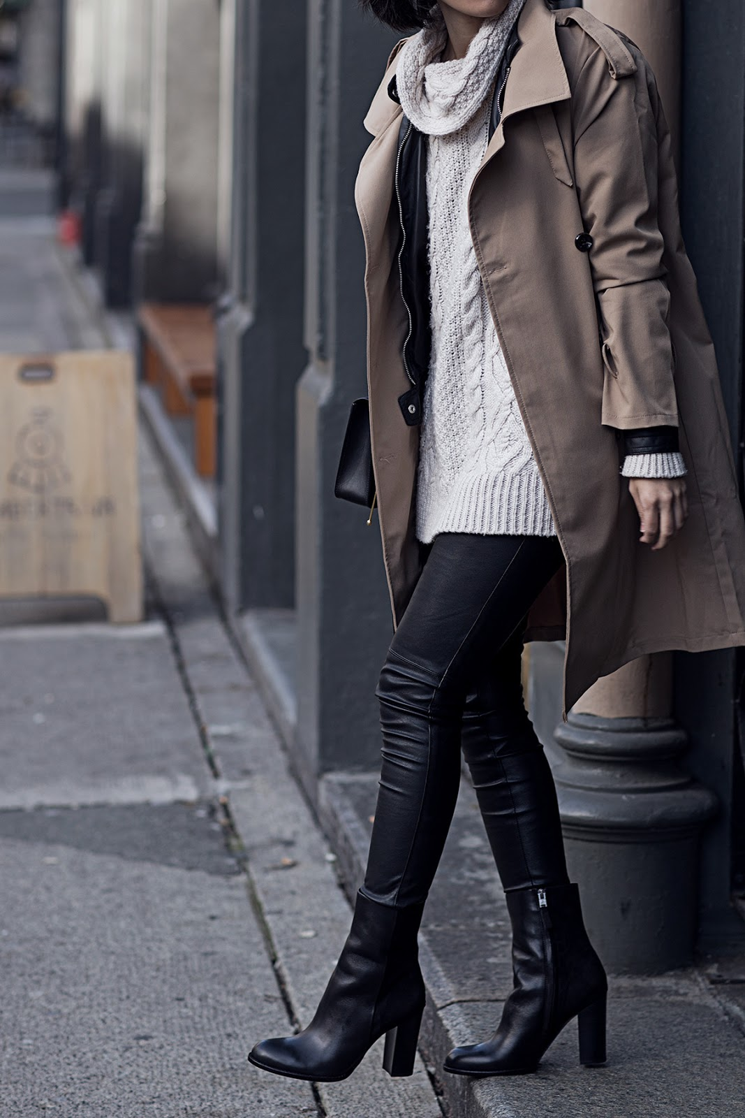 This classic brown trench coat looks edgy and sophisticated worn with leather leggings and heeled ankle boots. Via Claire Liu. Sweater: Zara, Jacket: Vero Moda, Coat: Korean brand, Leggings: H&M, Boots: Sam Edelman.