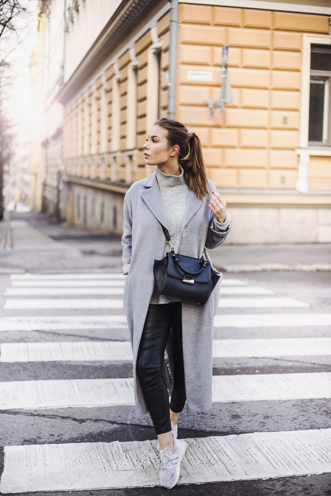 Pale grey items look great matched with black leather leggings as seen here worn by Katarina Lilius. The long coat trend is also huge this season; try getting a similar one to this from Topshop. Coat/Top: Topshop x Nelly*, Trousers: H&M, Sneakers: Adidas, Bag: Mango.