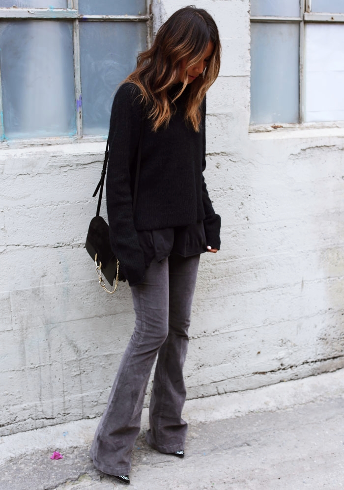 Flared cords are making a comeback; try wearing a pair with a blouse and sweater to make it appropriate for winter conditions. Via Julie Sarinana. Sweater/Cords: Paige Denim, Bag: Chloe Faye.