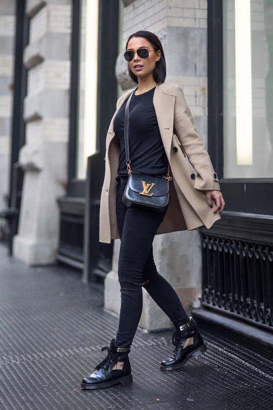 Break up an all black outfit with a beige coat like Johanna Olsson to join in on this new and growing trend. Wear the look with funky boots to add edge and authenticity. Coat/Jeans: Zara, Boots: See by Chloe, Tee: Enza Costa, Bag: Louis Vuitton.