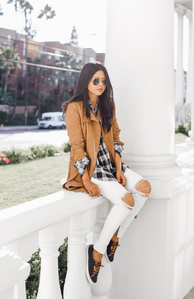 Plaid will never go out of trend! Sheryl Luke wears a simple black and white check shirt with distressed white jeans and a camel suede jacket, a great look for casual outings. Shirt/Shoes: Sperry, Trench: All Saints, Jeans: RTA.