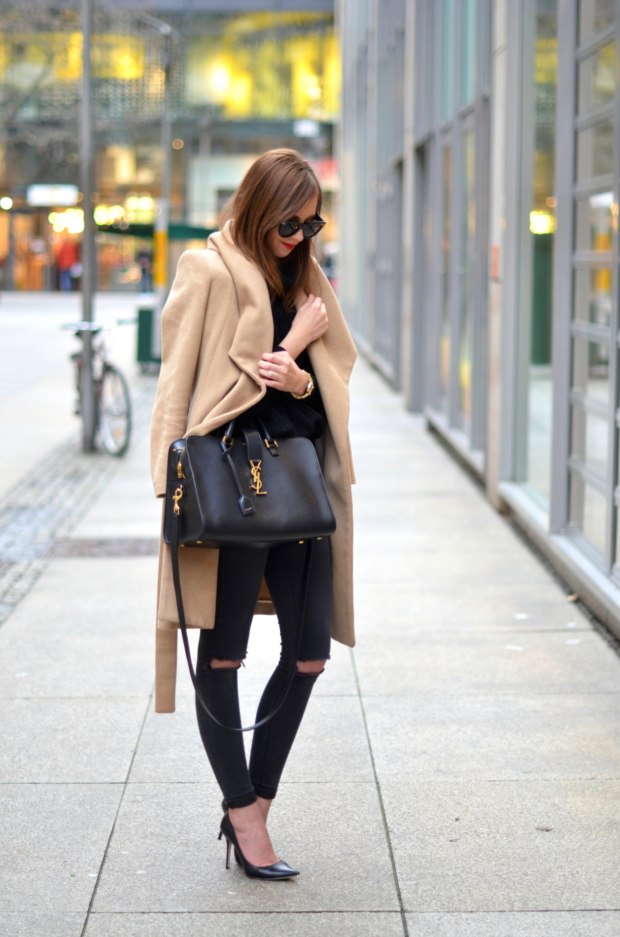 Camel coats look great worn over an all black outfit like this one, made up of a black turtle neck top and distressed black denim. Via Barbora Ondrackova. Coat: Mango, Turtle Neck: American Apparel, Jeans: Topshop, Heels: Jimmy Choo.