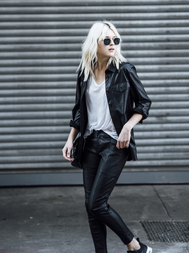 Rima Vaidila is wearing a leather shirt and matching leggings; totally rocking the biker girl style. Wear the trend with sneakers and a plain white tee to recreate this look. Shirt: iebeskind Berlin Leather, Trousers: J Brand, Tee: Helmut Lang, Bag: Saint Laurent.