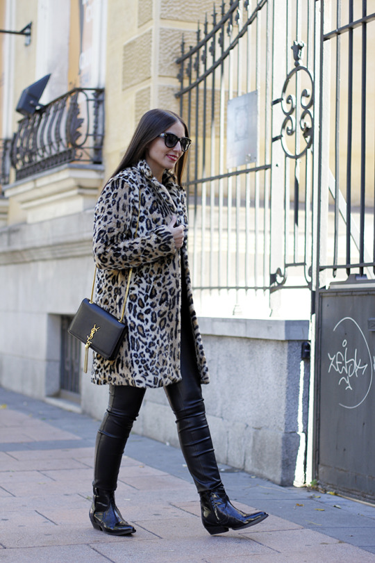 Leopard print will simply never go out of style. Erea Louro rocks the pattern on a statement faux fur coat, worn stylishly with leather leggings and patent black boots. Sweater/Trousers/Boots: Zara, Coat: Pepe Jeans, Sunnies: Fendi.