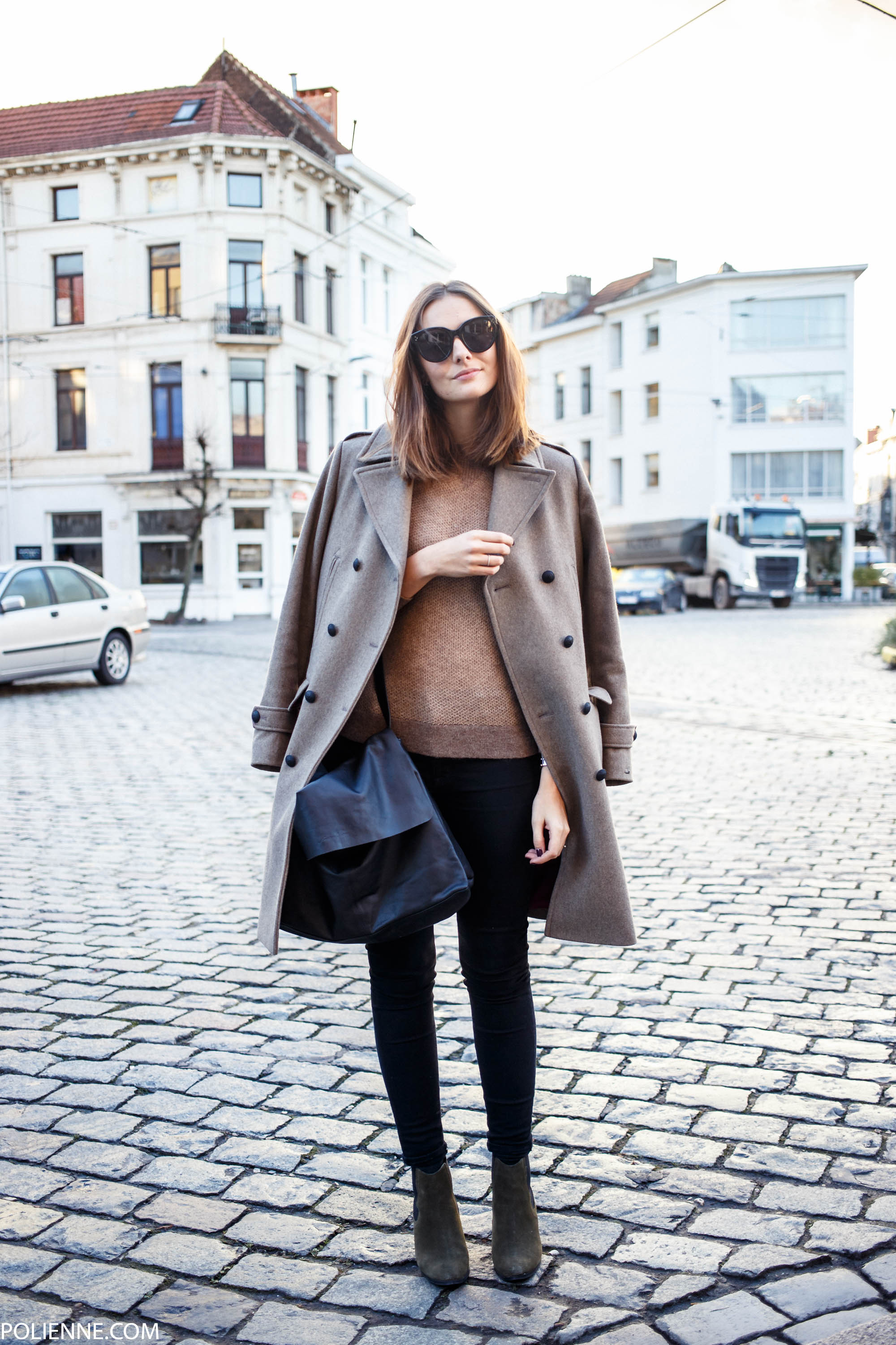 Paulien Riemis is wearing a sophisticated double breasted coat with a matching knit sweater and skinny black denim jeans. Try wearing this look with Chelsea boots and a leather satchel to get a similar style. Coat: Tommy Hilfiger, Jeans: Cheap Monday, Boots: River Island, Bag: American Vintage.