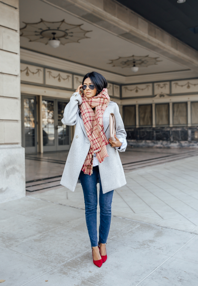 Wear bold colours to brighten up your look this winter! Sheryl Luke wears calming pastel blue shades on her coat and jeans, and adds some fire to the look with a pair of statement red heels and a patterned scarf. Shoes: Sole Society, Coat: AYR, Jeans: Asos, Shirt: Frank and Eileen.