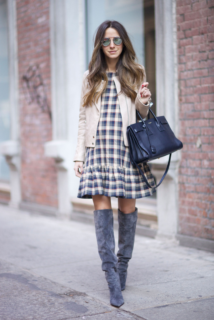 Plaid is a classic trend! Arielle Nachami wears a cute plaid midi dress with over the knee boots and a casual tan jacket. Wear the look with tights if you have to brave the cold! Dress: The Great, Boots: Gianvito Rossi, Jacket: J Brand, Bag; Saint Laurent.