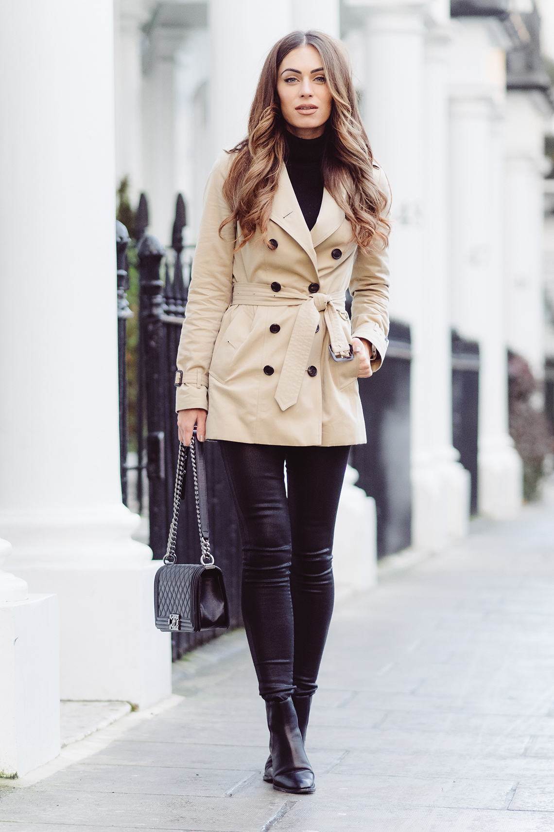 Wearing a classic beige trench coat is always a good option for getting those casual, sophisticated vibes. Lydia Lise Millen wears a Burberry trench with black denim jeans and sleek leather Chelsea boots. Trench: Burberry via Farfetch, Denim: Citizens of Humanity, Roll Neck: Jaeger, Boots: Saint Laurent, Bag: Chanel.