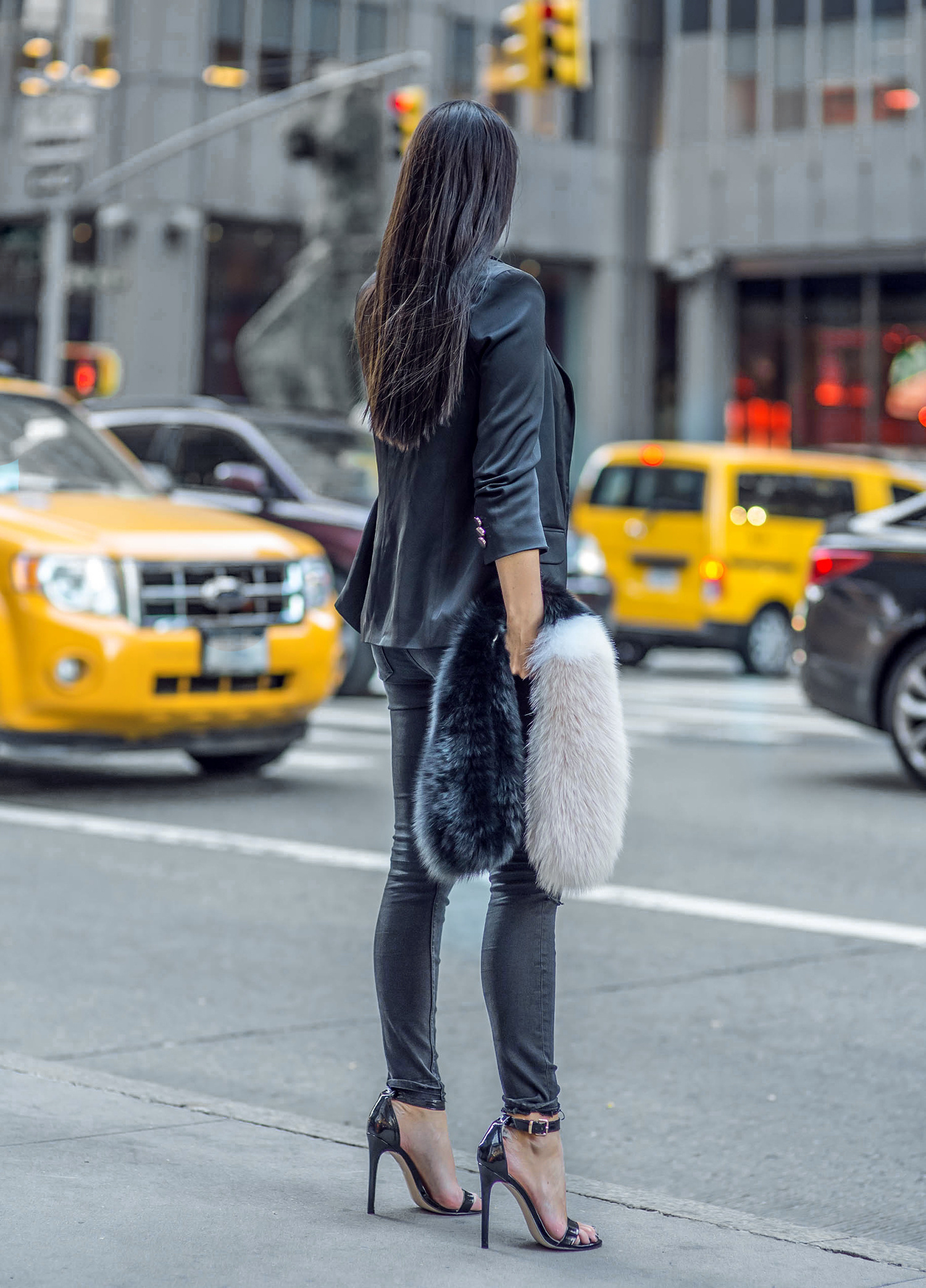 Johanna Olsson keeps it classy in a pair of shiny stilettos, a business style blazer and jeans. Accessorising the outfit with a fluffy scarf also adds to the overall edginess of the look. Brands Not Specified.
