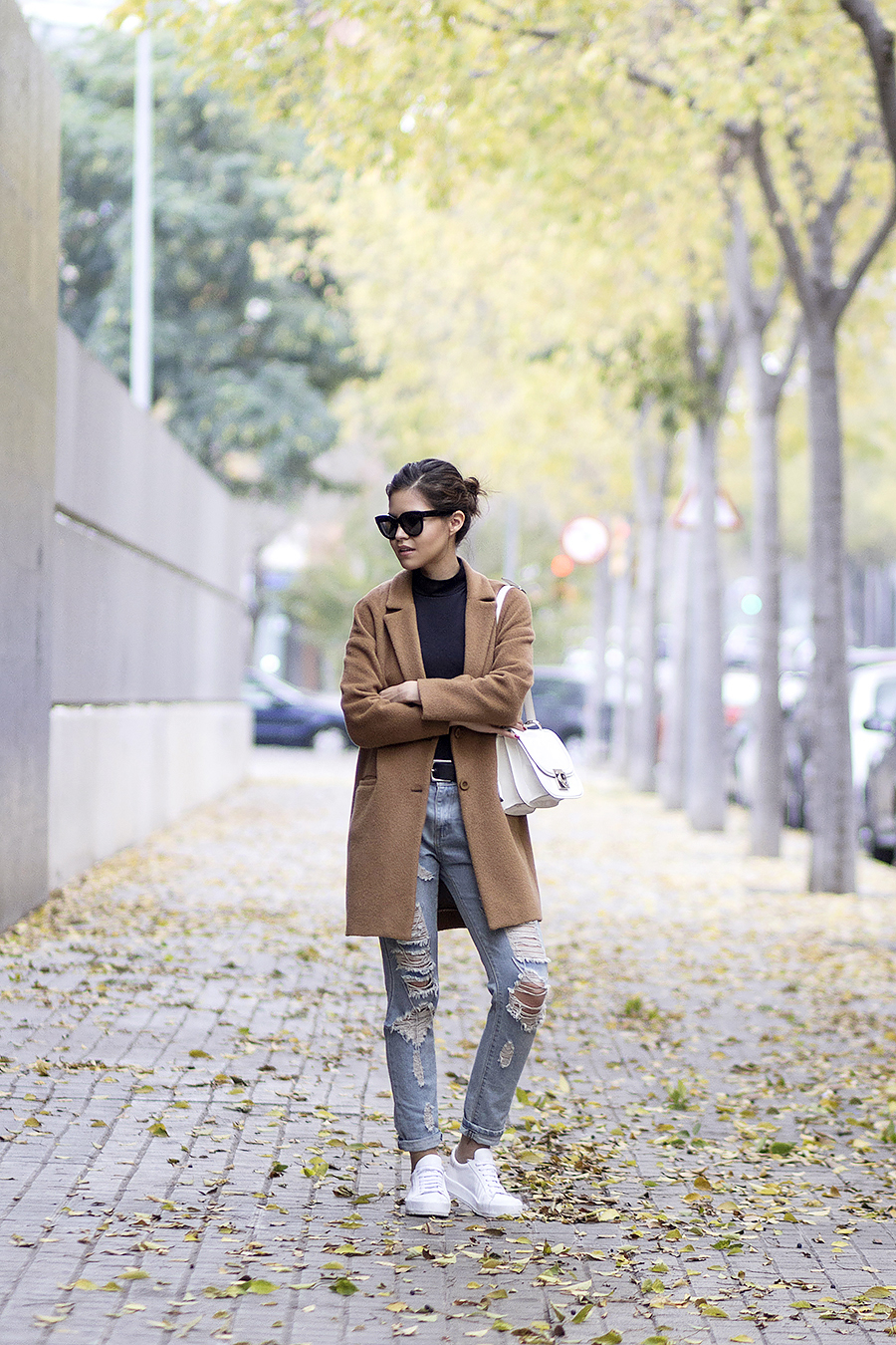 Ripped jeans are the ultimate tomboy item, and are perfect for combining with casual knitwear or a plain tee for an easy winter look. Via Adriana Gastélum. Coat: Gap, Shoes: Lost Ink.