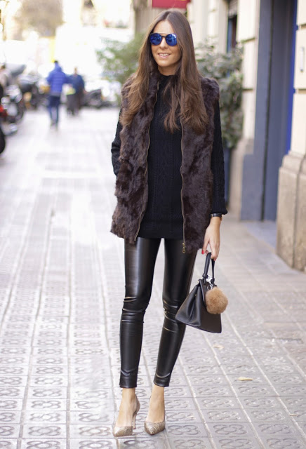 Leather leggings and faux fur make a fabulous combination. Sandra Buisan wears the trend with a casual knitted sweater and custom made patent heels; a stylish and easy fall outfit. Outfit: O8O Chic.