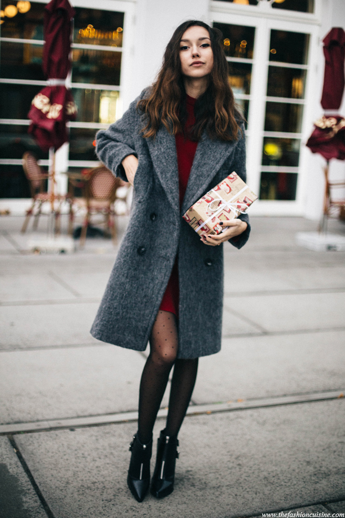 Beatrice Gutu's look consists of a red 60s inspired dress, a super cosy oversized coat and ankle boots with track sole; perfect for the coming winter season. We love this ulta sophisticated look. Outfit: Asos.