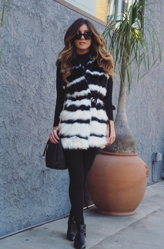 Faux fur is the ultimate winter style, what with its fluffy, cosy and festive feel. Deniz Selin is wearing a statement fur vest with waist tie detail paired with simple black denim jeans and a pair of black ankle boots. Fur Vest: Forever 21, Leggings/Turtleneck: Old, Boots: JustFab, Bucket Bag: Dynamite Clothing.