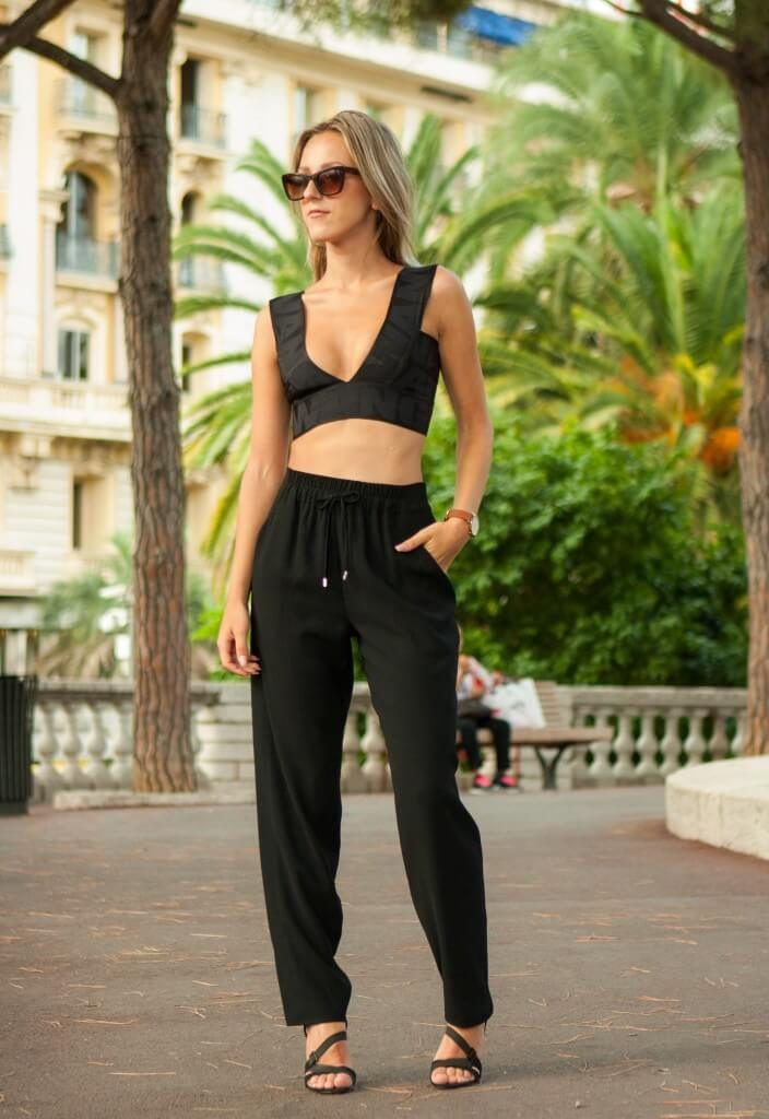 Consider wearing joggers with a crop top in warmer weather for the perfect beach look! Via Anna Belle Clarenburg.   Top: Alexander Wang for H&M, Joggers: Karen Miller, Heels: Zara, Watch: Rosefield.