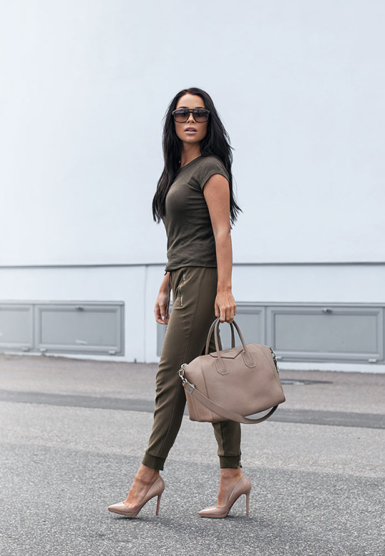 Copy Johanna Olsson's casual but stylish look by wearing a khaki T-shirt and matching joggers with a pair of nude heels.  Bag: Givenchy.