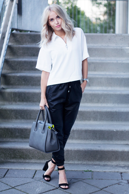 The leather jogger trend looks best worn simply with a minimalistic blouse like this one worn by Anita. Via Just The Design.   Trousers: The Sting, Heels: Zara, Bag: Paul's Boutique.