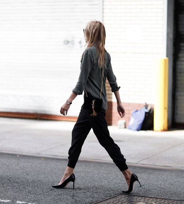 Pair your joggers with a blouse and heels to smarten up the outfit and get Lisa D Cahue's trendy look.  Top: Splendid, Trousers: ATM, Shoes: Manolo Blahnik, Bag/Sunnies: Saint Laurent.