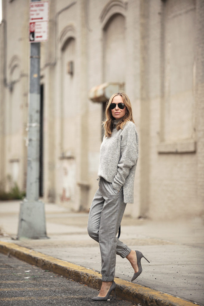Fabric joggers can look great, especially worn with matching heels and a knitted sweater. Via Helena Glazer.  Sweater: Anine Bing, Trouers: Topshop, Shoes: Manolo Blahnik, Bag: Celine.
