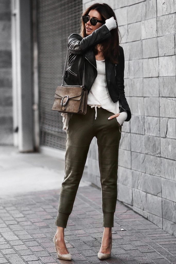 Erica Hoida looks comfortable yet totally chic in these khaki joggers, worn with heels and a leather jacket for a smarter overall style. We love the casualness of this look, and definitely recommend it for 2017!  Jacket: Marissa Webb, Shirt: Free People, Joggers: Sincerely Jules, Shoes: Gianvito Rossi.