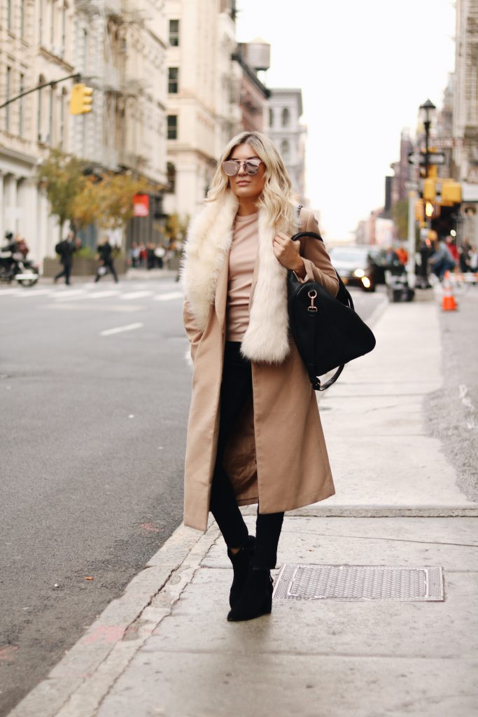 Venice Greel looks ultra glamorous in this classic style beige coat, worn with a gorgeous faux fur collar stole. Wear this look with black jeans and suede boots for a fabulous winter style.   Brands not specified.